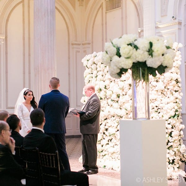 Wedding Ceremony Photo with Floral Wall