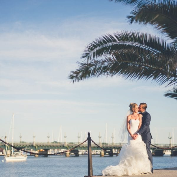 Bride and groom in front of The Bridge of Lions