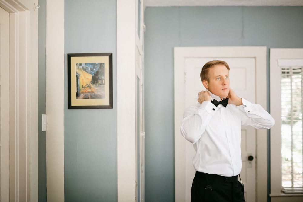 Groom getting ready for wedding at The Treasury on The Plaza, St. Augustine