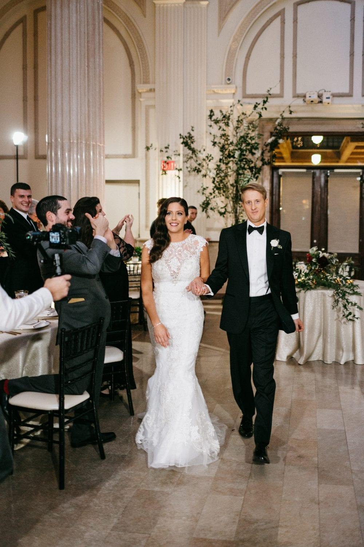 Bride and groom wedding reception entrance | Treasury On The Plaza | Treasury Venue Collection | St. Augustine
