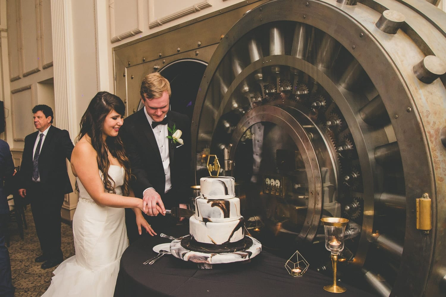 Cake cutting | Modern St. Augustine Wedding at The Treasury on The Plaza