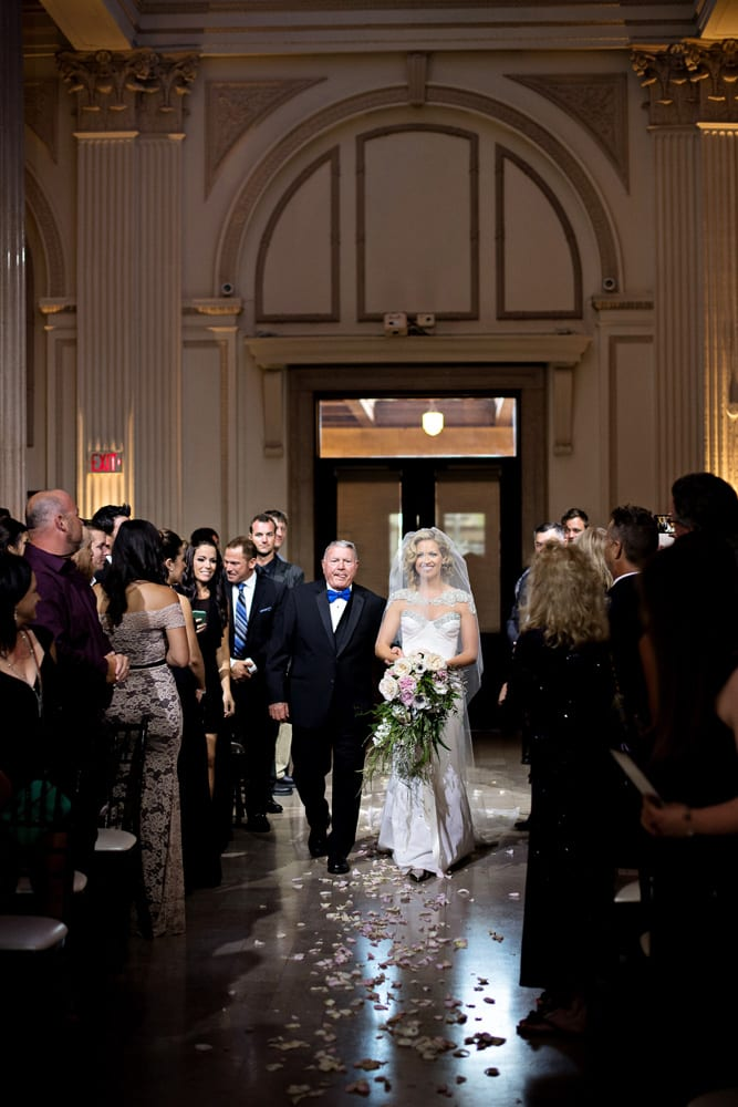 Bride Walking down the aisle | A Romantic Modern Wedding At The Treasury on the Plaza, St. Augustine