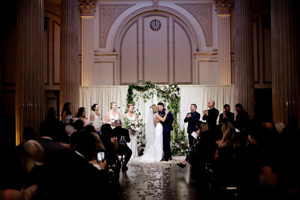 First Kiss | A Romantic Modern Wedding At The Treasury on the Plaza, St. Augustine
