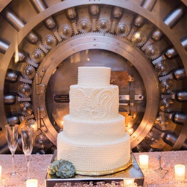 cake in front of bank vault door