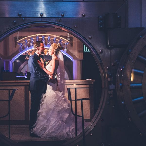 Bride and Groom inside of Bank Vault