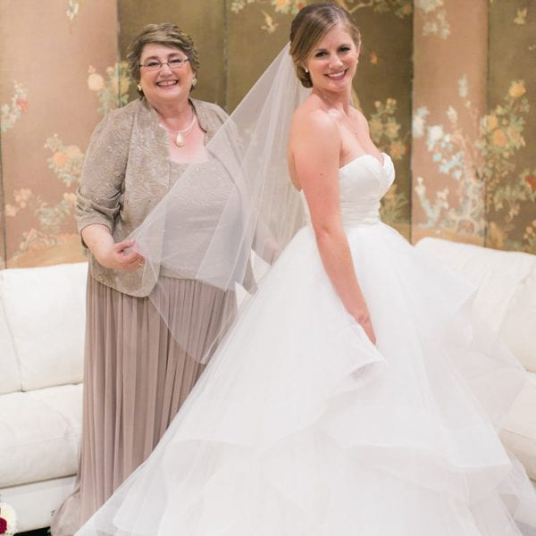 Mother helps bride get ready