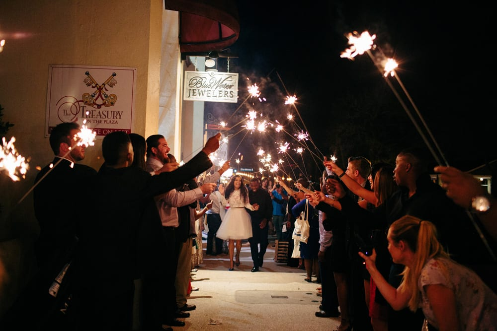 Bride and groom exit wedding at The Treasury on The Plaza St. Augustine