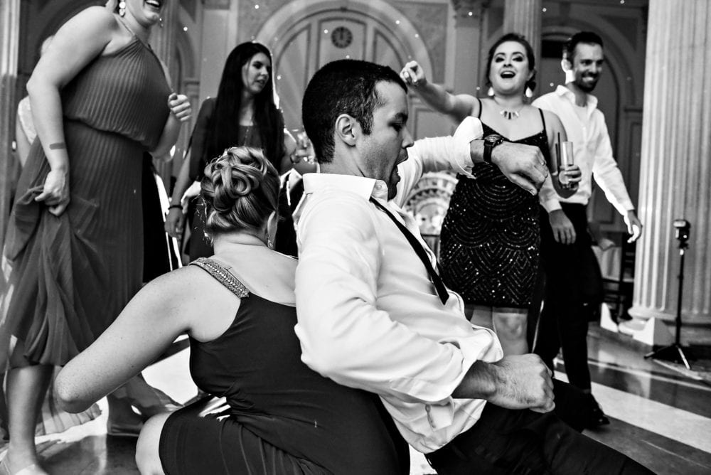 Groom dances at wedding reception