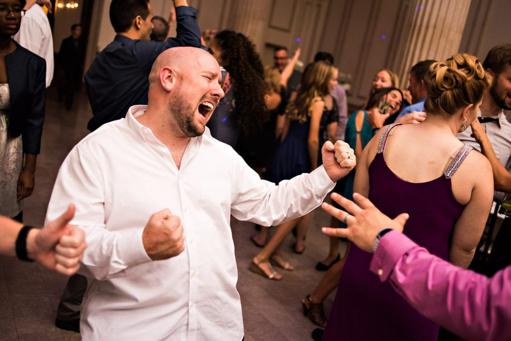 Guest dances during wedding reception