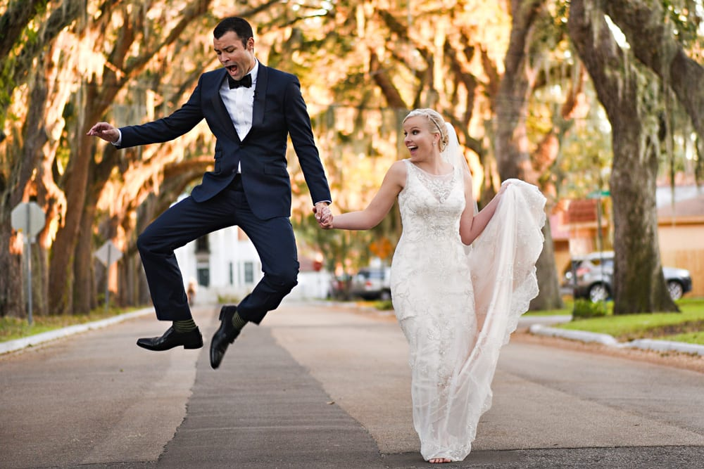 Groom jumping after wedding ceremony