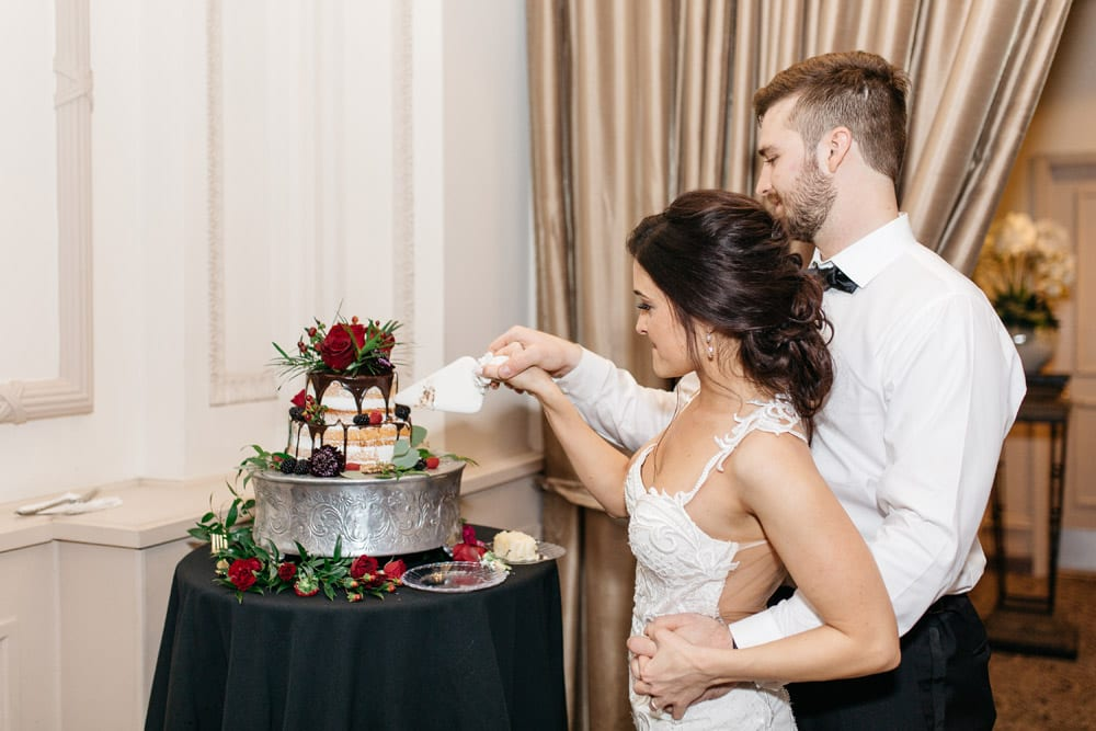 Cake Cutting | Kirsten + JC | Treasury on the Plaza Wedding Full of Surprises for Guests | St. Augustine Wedding Venue