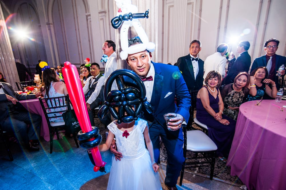 Balloon artist at The Treasury on the Plaza | 6 Ways to Make Your Wedding Reception More Fun
