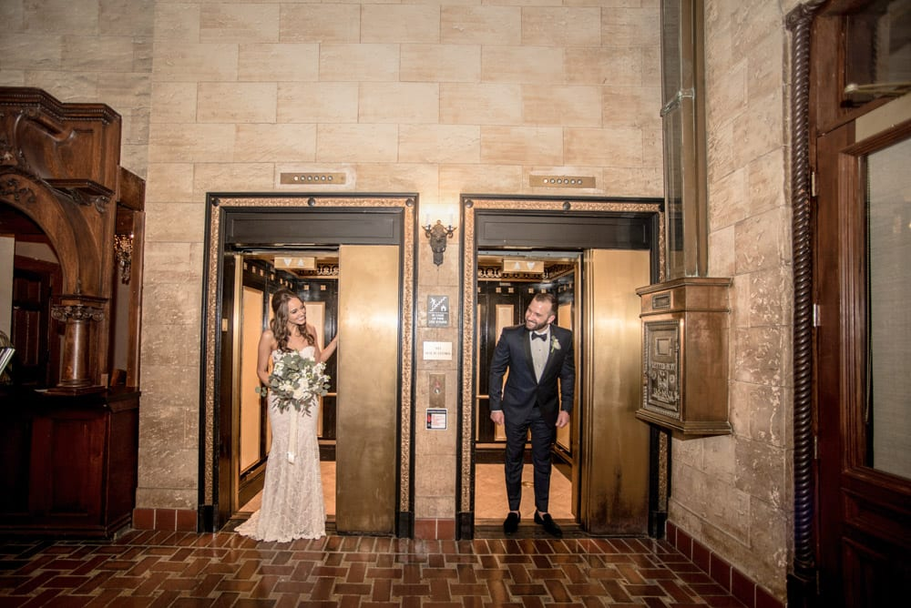 First look in Treasury on the Plaza elevators | An Intimate Wedding in St. Augustine | Mackenzie + Nick