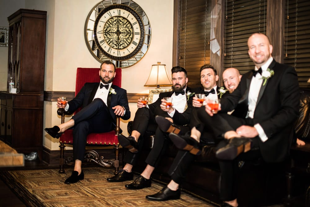 Getting ready in the groom's suite   An Intimate Wedding in St. Augustine   Mackenzie + Nick