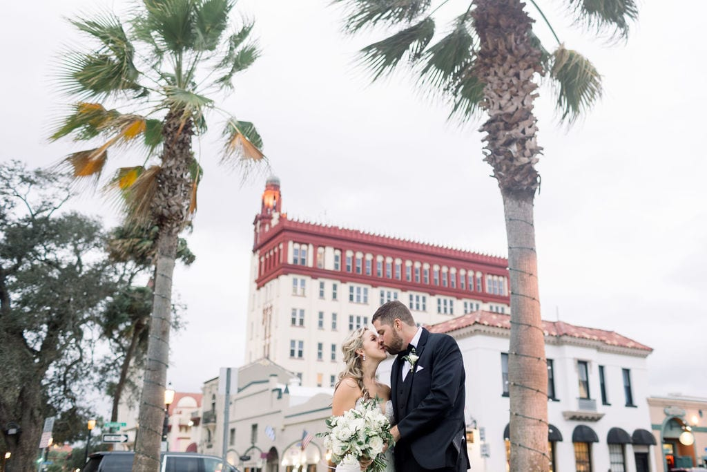 Wedding photo in front of The Treasury on the Plaza in St. Augustine