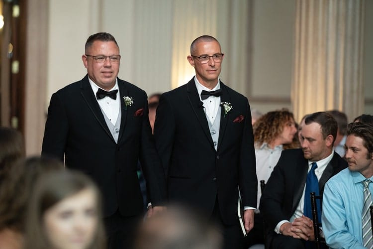 Father officiates wedding ceremony