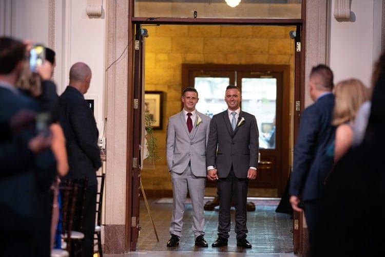 grooms walk down the aisle