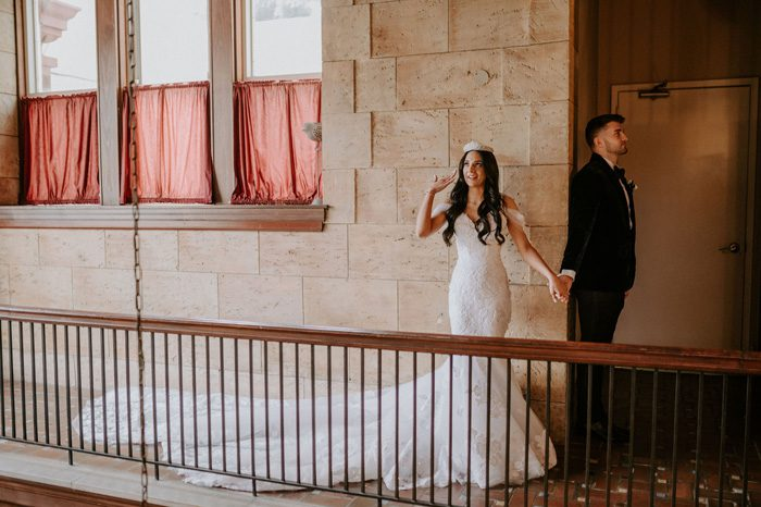 Bride and Groom First Look | Glam Wedding with a Rock and Roll Surprise at The Treasury | Cristal + Steven