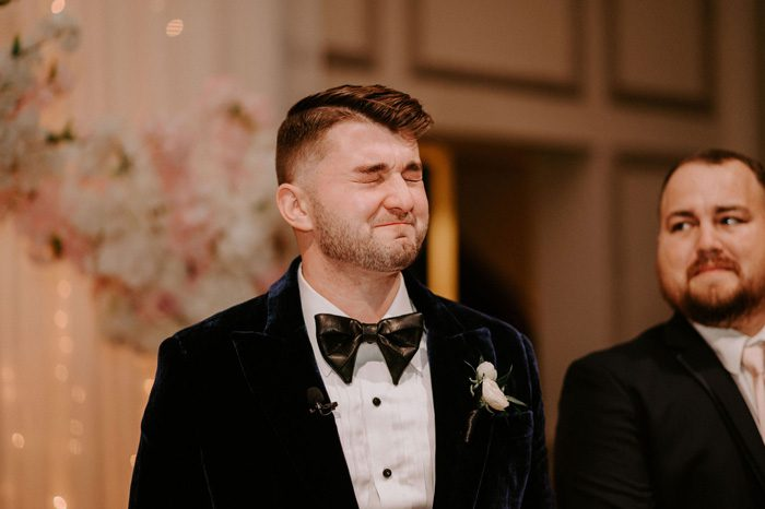 emotional groom during wedding ceremony | Glam Wedding with a Rock and Roll Surprise at The Treasury | Cristal + Steven