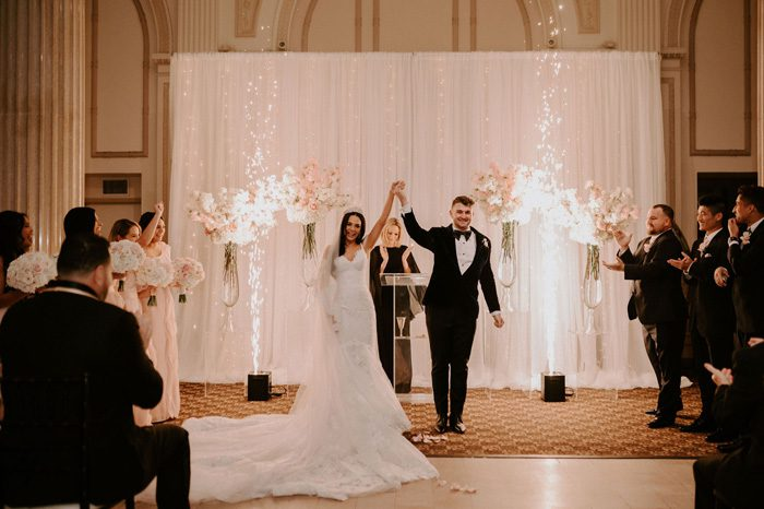 wedding ceremony sparklers | Glam Wedding with a Rock and Roll Surprise at The Treasury | Cristal + Steven