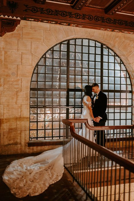 Treasury on the Plaza balcony |Glam Wedding with a Rock and Roll Surprise at The Treasury | Cristal + Steven