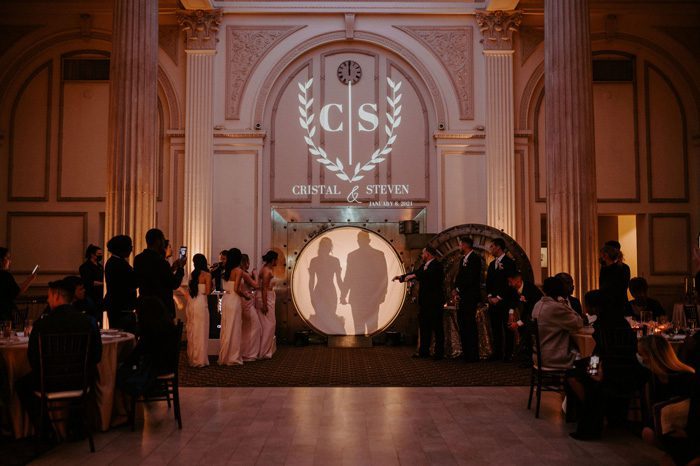 Wedding reception entrance from the vault| Glam Wedding with a Rock and Roll Surprise at The Treasury | Cristal + Steven