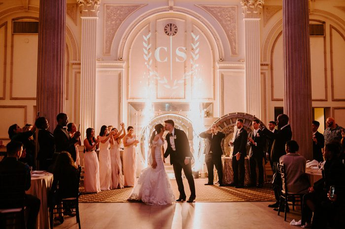 firework wedding reception entrance | Glam Wedding with a Rock and Roll Surprise at The Treasury | Cristal + Steven